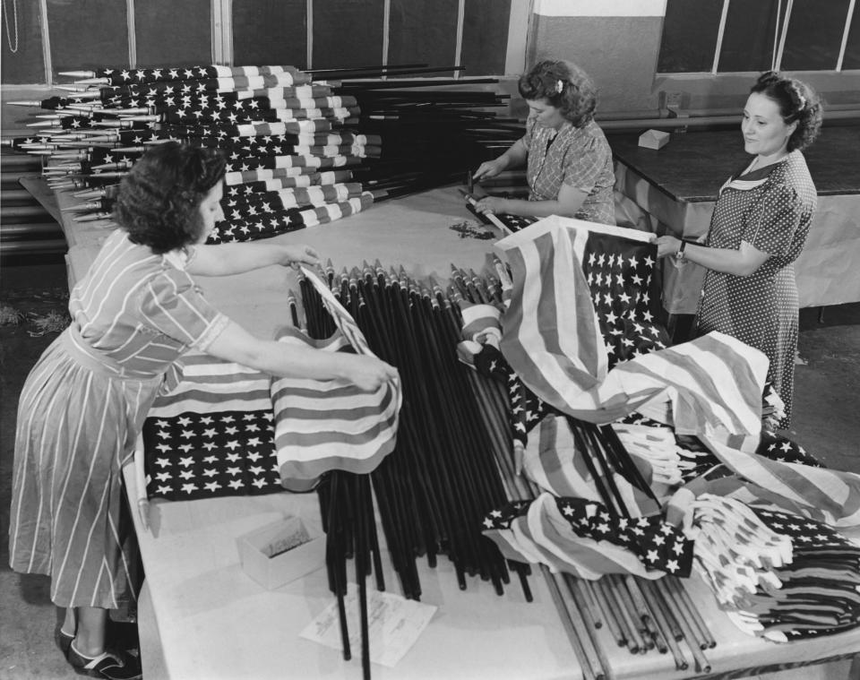 Three women making US flags in a factory, USA, circa 1945. (Photo by Frederic Lewis/Archive Photos/Getty Images)